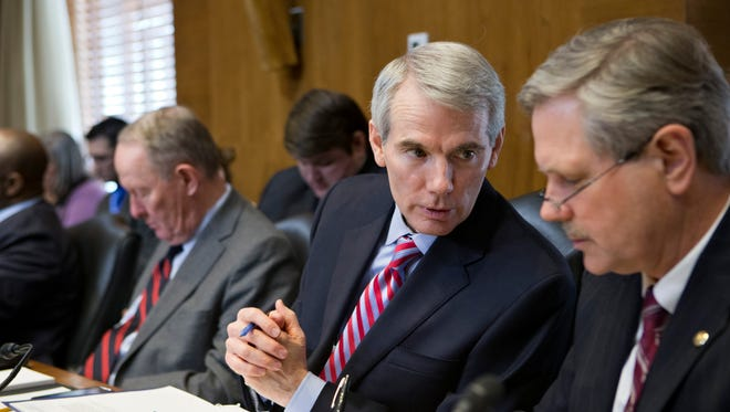 Senate Energy Committee members Sen. Rob Portman (left), R-Ohio, and Sen. John Hoeven, R-N.D., confer in this 2013 photo.