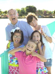 The Martin family poses in photos taken in July 2016,
