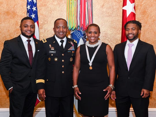 Lt. General Robert Ferrell is surrounded by his family