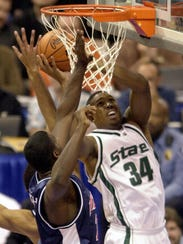 Michigan State's Andre Hutson (34) goes to the basket