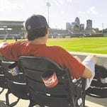 "Iowa Cubs grounds crew member Cory Harther watches the game against the Nashville Sounds on June 14, 2008. ""It's just weird not hearing the music when they walk up,"" said Harter."