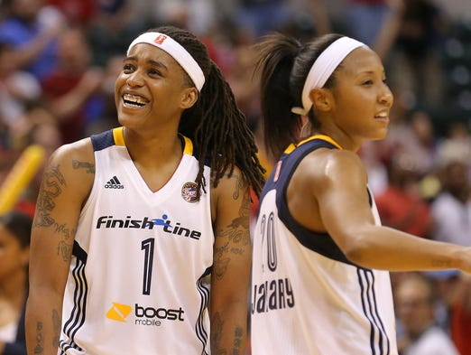 Indiana Fever guard Shavonte Zellous is all smiles with teammate Briann January following their 77-70 victory against the Chicago Sky during the first game of the Eastern Conference Finals inside Bankers Life Fieldhouse, on Saturday, August 30, 2014, in Indianapolis.