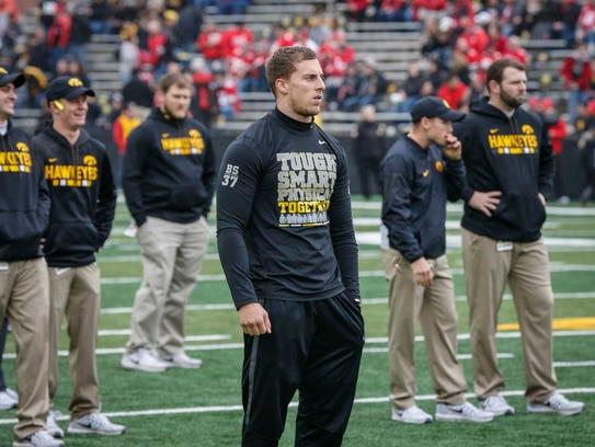 Iowa safety Brandon Snyder watches his teammates warm