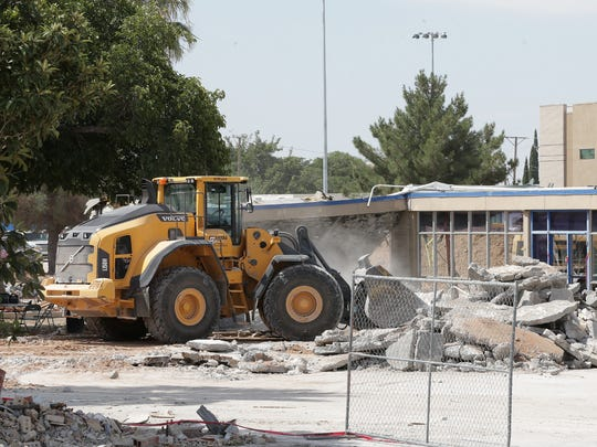 A bulldozer clears out what remains of Eastwood High School Wednesday.