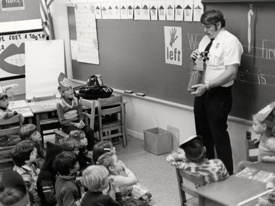 Former Croton firefighter Gerry Munson teaches students fire safety in 1977.