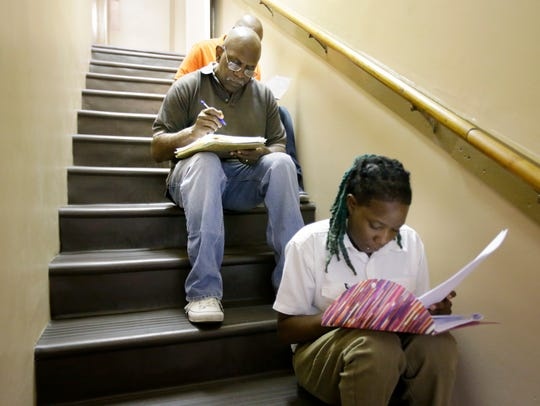 Jesse Thomas and Ashley Smith find a quiet stairwell to fill out applications during a job fair at  Church of God in Christ of Memphis in 2016. Since then, employers have added about 18,000 jobs, pushing the metro area March unemployment rate down to 3.9 percent. But concerns persist that most new jobs come with part-time hours, low wages and limited benefits.