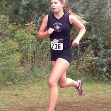 Isabella Garcia of Pinckney placed ninth in the Holly Invitational Division 2 race in 20:12 on Saturday at Springfield Oaks County Park.