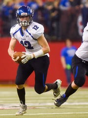 Irene-Wakonda quarterback Trey King (12) runs the ball during the second half of the Class 9AA football state championship game on Nov. 9, 2017 in Vermillion, S.D..