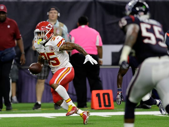 Kansas City Chiefs running back Charcandrick West (35) runs for a touchdown against the Houston Texans during the first half of an NFL football game, Sunday, Oct. 8, 2017, in Houston.