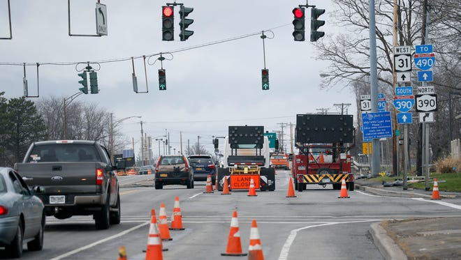 Trucks and signs warn of lane closures at the Lyell Avenue bridge over Route 390. The project is expected to disrupt traffic this spring and summer.