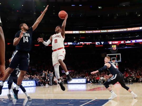 St. John's Shamorie Ponds (2) shoots over Villanova's Omari Spellman (14) during the second half of an NCAA college basketball game Saturday, Jan. 13, 2018, in New York. Villanova won 78-71. (AP Photo/Frank Franklin II)