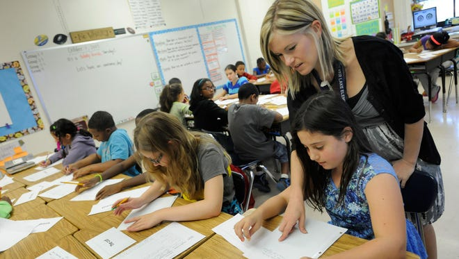 More than 40 states are adopting Common Core Learning Standards. In Delaware, Amy Lawson, a fifth-grade teacher at Silver Lake Elementary School, works with students on an English Language Arts lesson.