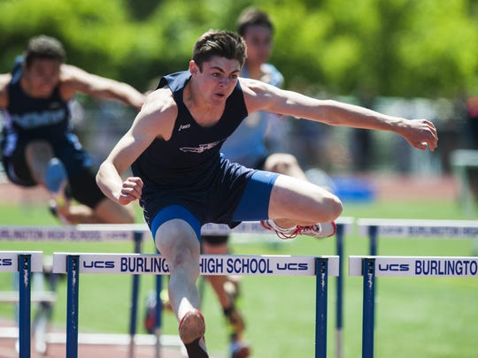 Mount Mansfield's Alec Eschholz competes in the 110-meter hurdles race at the Division I track and field state meet earlier this month.
