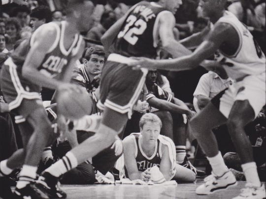 Larry Bird rests his back during the 1991 NBA playoffs.