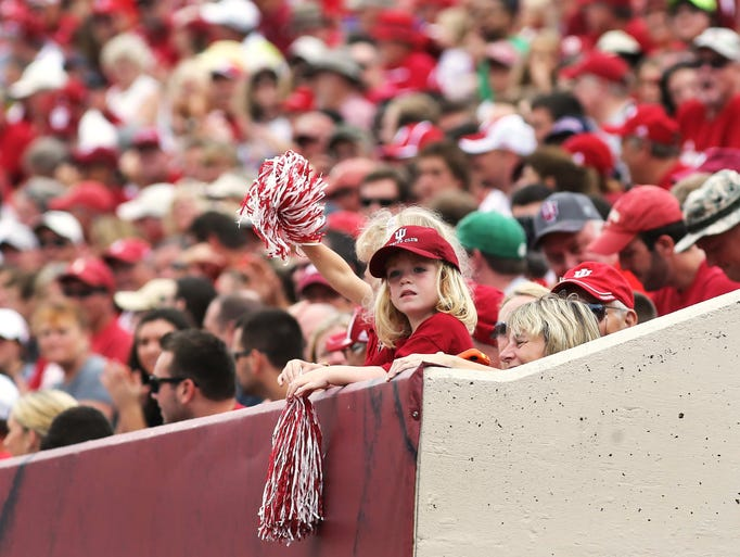 a young fans wavers her pompoms in the stands as Indiana University defeated Indiana State University 28-10 in a football game at Memorial Stadium in Bloomington Saturday August 30, 2014.