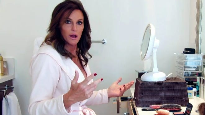 Caitlyn Jenner applies makeup in a scene from E!'s reality series 'I Am Cait'