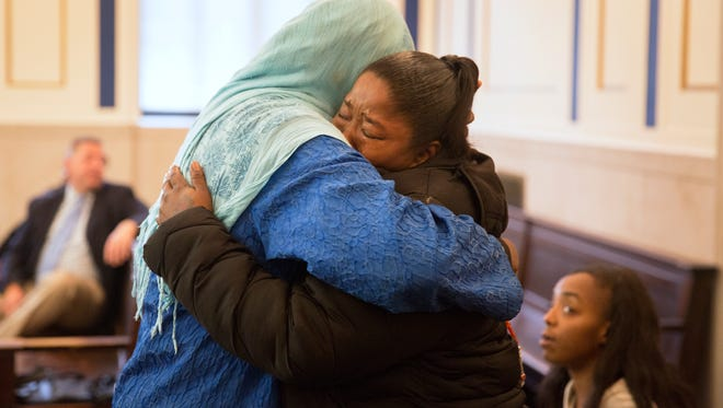 Malyyka Bonner, 32, right, gets a hug from Rukiye Abdul-Mutakallim, 66, after the plea deal for Bonner's son, Javon Coulter, 16. Coulter admitted guilt in the shooting death of Abdul-Mutakallim's son, Suliman Ahmed Abdul-Mutakallim.