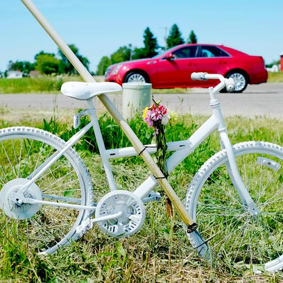 A ghost bike rests at the scene of a fatal accident where a St. Johns man on a bicycle was killed by a car at the intersection of St. Joseph Highway and Mulliken Road Saturday afternoon. The victim was likely a participant in the 37th Annual 100,000 Metre T-Shirt Ride, an event which takes cyclists on a 62-mile route from Grand Ledge to Vermontville to Lake Odessa and back.