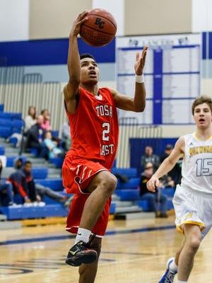 Wauwatosa East senior Amire Williams-Stribling (2) drives in for a layup during the Luke Homan Memorial Showcase game against Mukwonago at Brookfield Central on Saturday, Jan. 20, 2018.