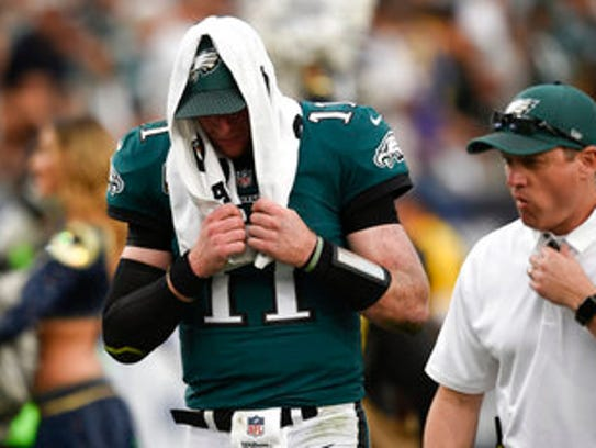 Eagles quarterback Carson Wentz leaves the field in the third quarter on Dec. 10 after tearing his ACL.