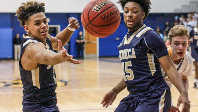 Braden Galloway, left, and Charles Shabazz battle for a ball against Travelers Rest. The Seneca boys' team was ranked No. 2 in Class AAA in the recent SCBCA polls.