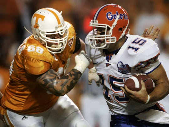 Matt McGlothlin (60) tries to get his hands on Tim Tebow (15) as the Tennessee plays Florida at Neyland Stadium on Sept. 16, 2006.
