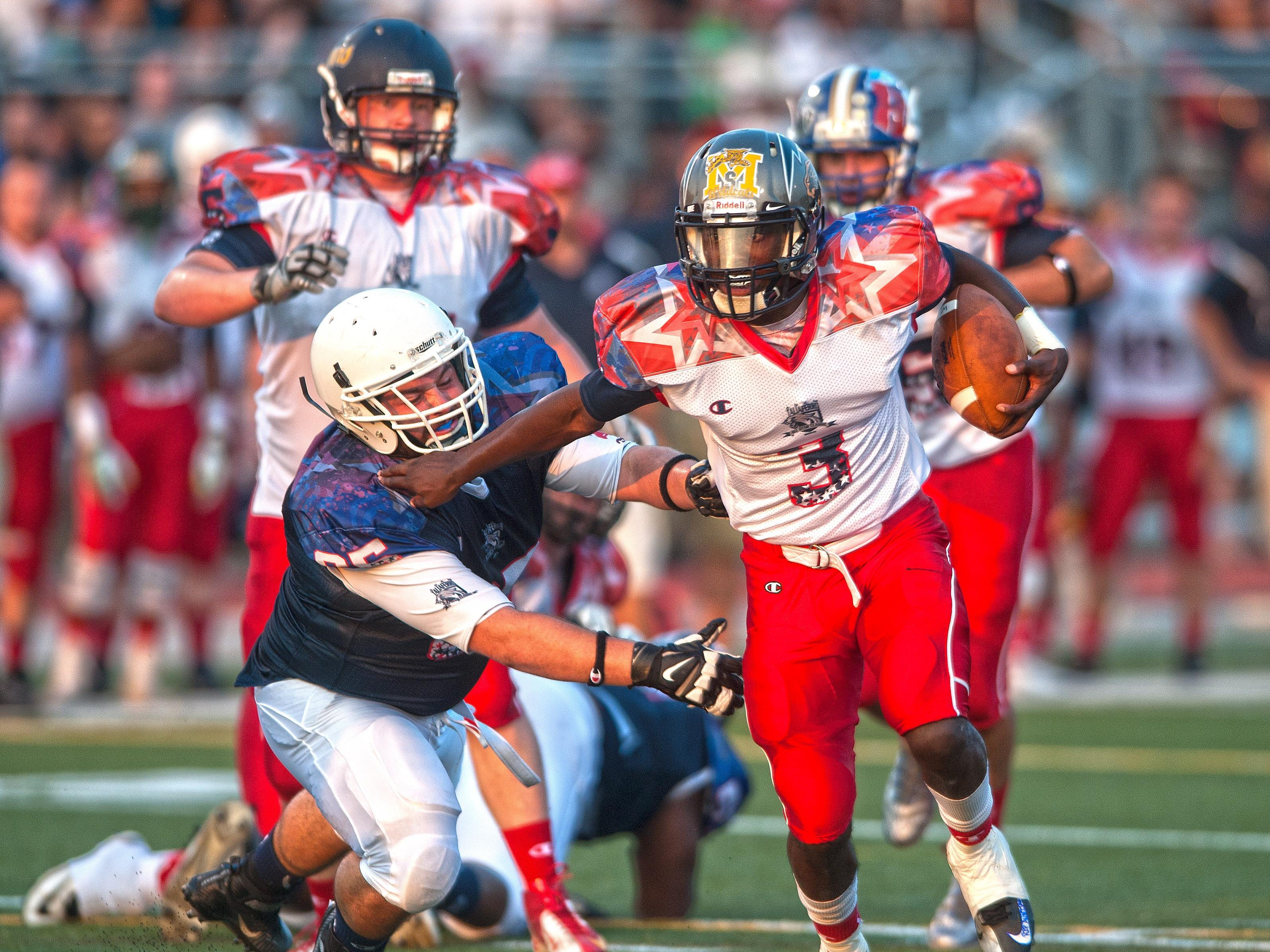 White Squad quarterback Khalil Trotman breaks away from Blue Squad Joe Greco during the second quarter of the South Jersey Coaches-Adam Taliaferro All-Star Football Classic.