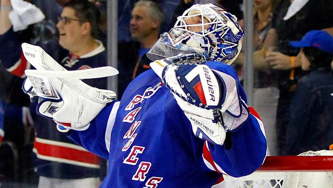 New York Rangers goaltender Henrik Lundqvist looks skyward after a Game 6 win against the Pittsburgh Penguins.