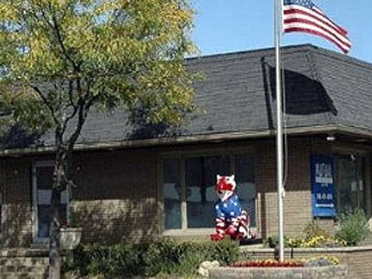 A tiger statue sits outside  Mutual Property Management and Realty in Farmington. It was stolen this week.