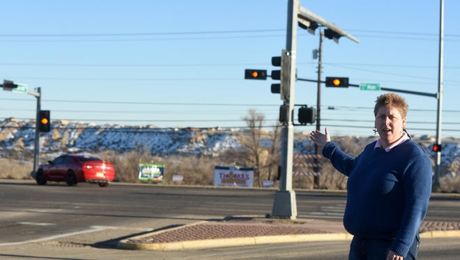 City Engineer Nica Westerling talks about the specifics of the planned expansion of Piñon Hills Boulevard on Thursday at the street's intersection with East Main Street.