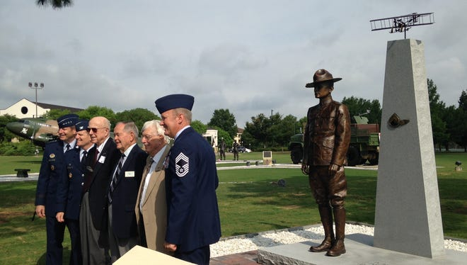 From left to right, Gen. Robin Rand, sergeant pilots, James Pool, John Beard and Charles Fisk and Chief Master Sgt. Fred Graves, director of the Enlisted Heritage Hall and Research Institute stand in front of the newly dedicated Enlisted Pilots of the Air Force monument.
