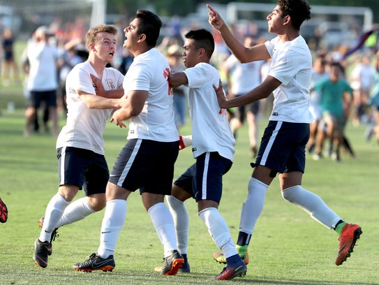 Blackman players celebrate after beating Brentwood with penalty kicks in the semifinal game May 23.