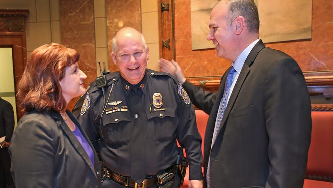 Frederick Ilnicki (center) introduced his wife, Marcia Ilnicki, to IMPD Chief Troy Riggs after an IMPD promotion ceremony Monday, Feb. 8, 2016, at the Indiana War Memorial in Downtown Indianapolis. Ilnicki was promoted to captain.