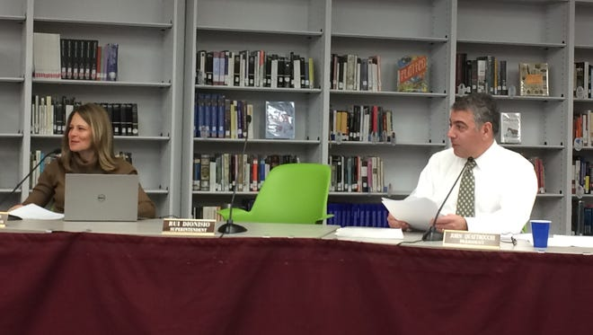 Verona Business Administrator Cheryl Nardino, at left, and Board of Education President John Quattrocchi, at right, talk about the 2017-2018 budget during a Tuesday, March 21, 2017 meeting.