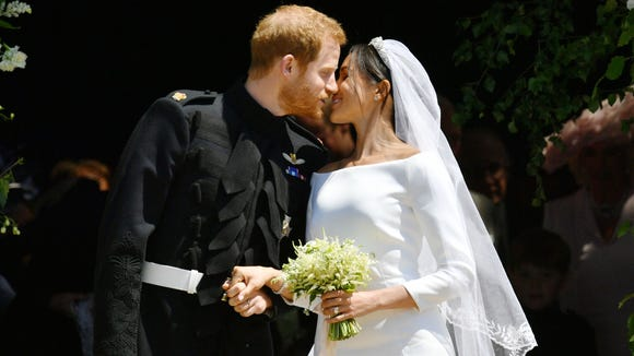 The Duke and Duchess of Sussex share their first married kiss as they exit St. George's Chapel at Windsor Castle.