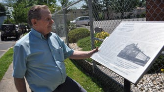 Gunter Kuprat, 81, examines a landmark description of the Carlstadt Turnverein Hall.