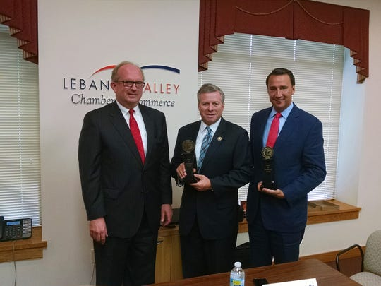 Jack Howard, left, of the U.S. Chamber of Commerce, presents Congressman Charlie Dent, center, and Congressman Ryan Costello with the 'Spirit of Enterprise Award' for their support of American business on Thursday at the Lebanon Valley Chamber of Commerce where they both spoke and took questions at the Chamber's Public Affairs Roundtable event. Both congressmen represent part of Lebanon County.
