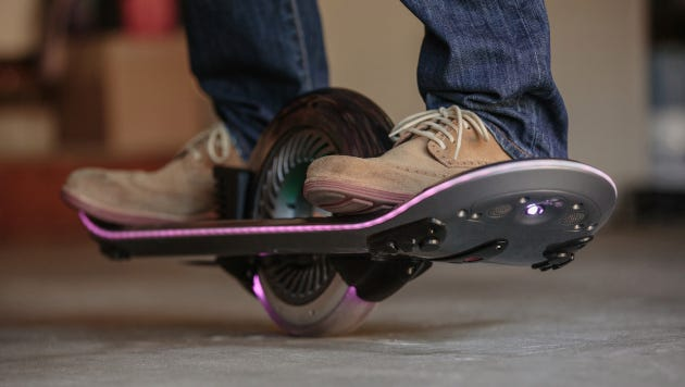 The Hoverboard, a skateboard rolling on one wheel to mimicking levitating off the ground.