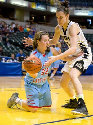 Jac-Cen-Del High School sophomore Lilly Simon (22) struggles to pass the ball off to a teammate as she's defended by Argos High School junior Anna Barlow (50) after getting a rebound during the first half of the IHSAA 1A Girls' Basketball State Championship game, Feb. 27, 2016, at Bankers Life Fieldhouse.