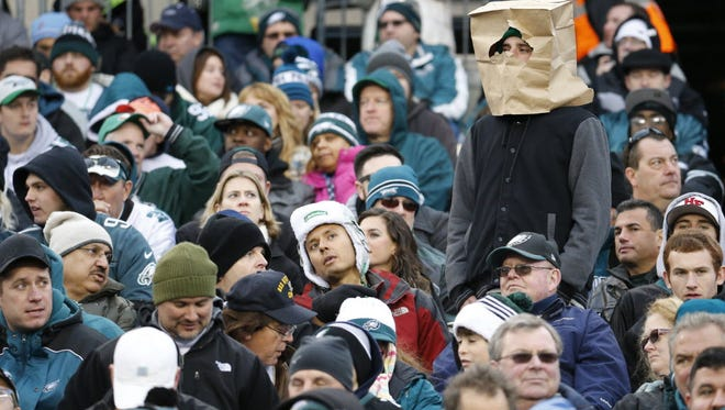 One Philadelphia Eagles fans watches team play with bag on head.