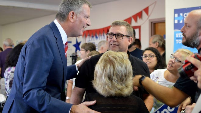 New York Mayor Bill de Blasio speaks to Hillary Clinton volunteers at a canvassing kickoff event in Milwaukee on Sunday.