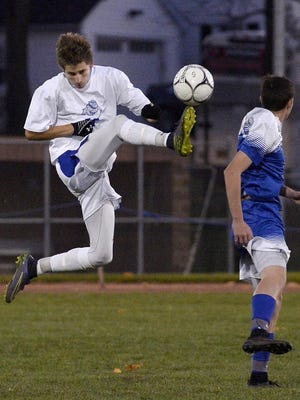LivoniaÕ' Troy Rossborough, left, clears the ball away from Westhill's Braeden Elmer during a Class B semifinal at the 2016 state boys soccer championships at Middletown High School on Saturday, Nov. 12, 2016. Livonia ends its season with a 2-1 loss to Westhill-III.