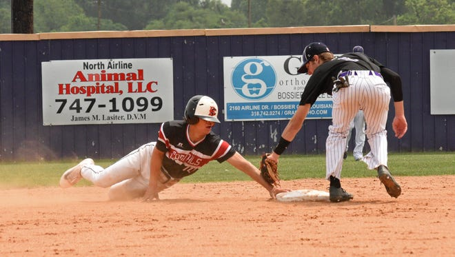 Benton's Garrett Hable tags out Belle Chasse's Matt Barthelemy at second in their Saturday playoff game.