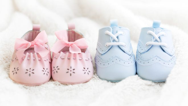 Baby shoes for a boy and a girl.
