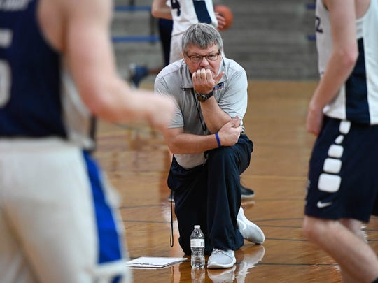 Reitz boys basketball head coach Mike Adams watches his players run a drill during after school practice at Reitz High Monday, November 20, 2017.