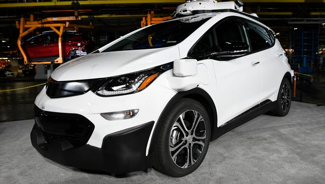A  self-driving Chevrolet Bolt EV that is in General Motors Co.'s autonomous vehicle development program appears on display at GM's Orion Assembly in Lake Orion, Mich. General Motors expects to have autonomous vehicles working commercially in big cities sometime in 2019.