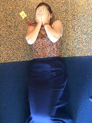 Woman, pictured, matches floor beneath her.