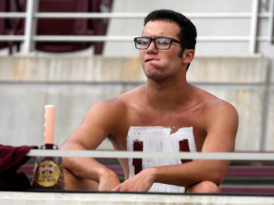 A Mississippi State fan, cowbell in tow, shows his displeasure at the outcome of a Bulldogs game.