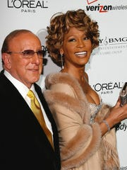 Music mogul Clive Davis, left, had reservations about Houston playing 'Bodyguard' leading lady Rachel Marron, fearing that acting could stall her singing career.
