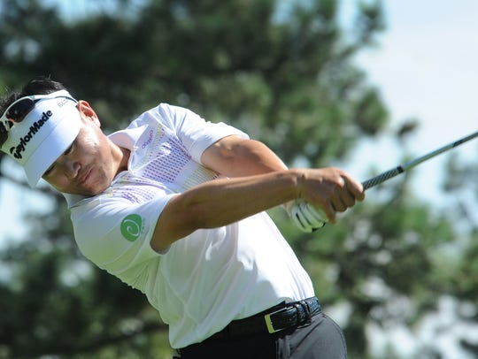Former Nevada golfer Charlie Wi hits his tee shot on